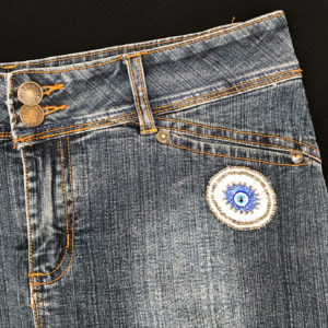 Mini jupe en jean Upcyclée - The eye